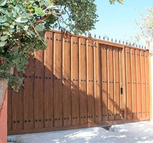 Puertas garaje madera modelos de puertas garaje sivelox for Modelos de puertas de garaje